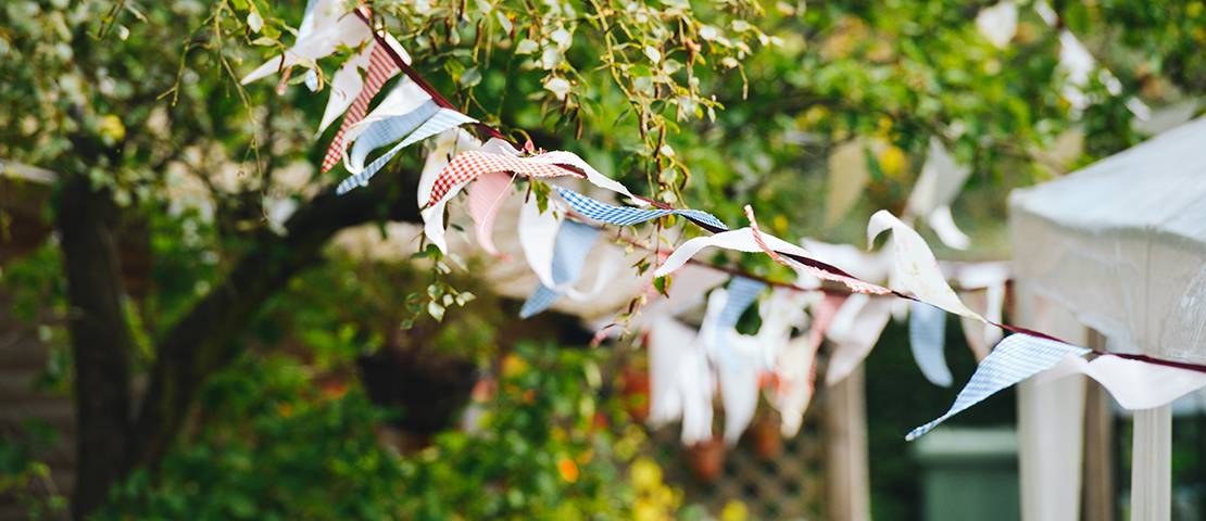 Bunting flags hanging from a tree