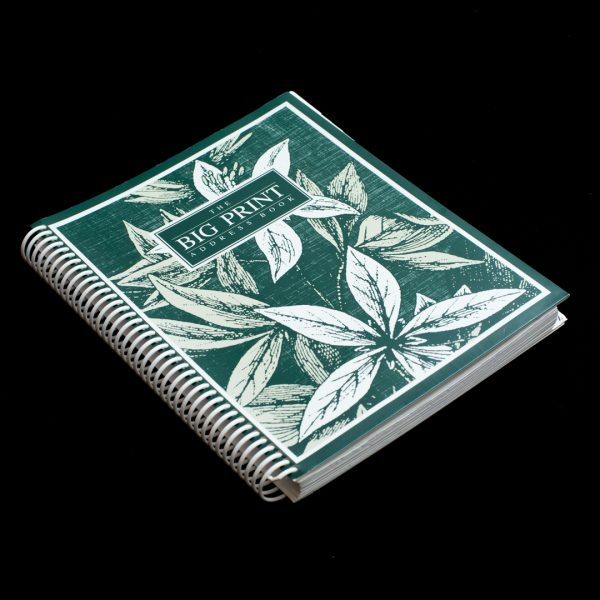 A large print address book with a green leaf pattern on the cover