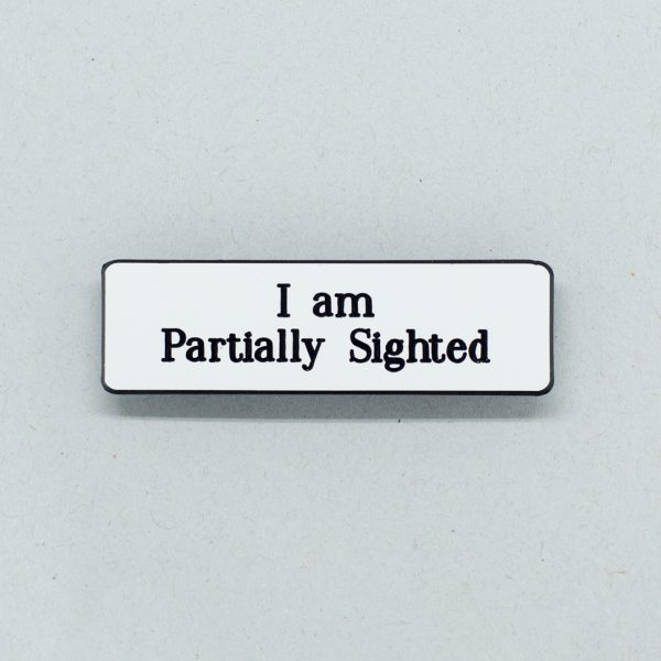 Small badge reading with text saying I am Partially Sighted