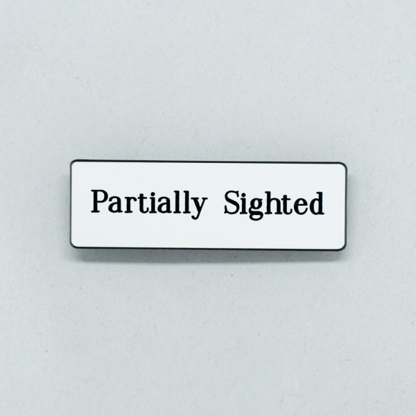 Small white badge with black text that says Partially Sighted