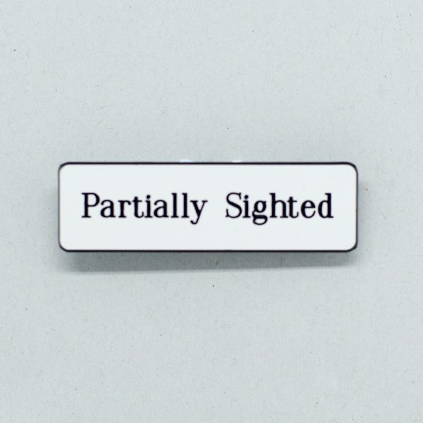 White lapel badge with black text that says Partially Sighted