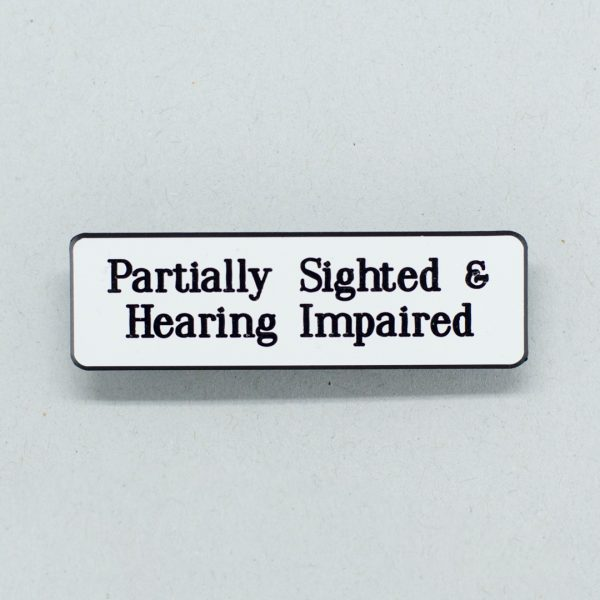 White lapel badge with black text that says Partially Signted & Hearing Impaired
