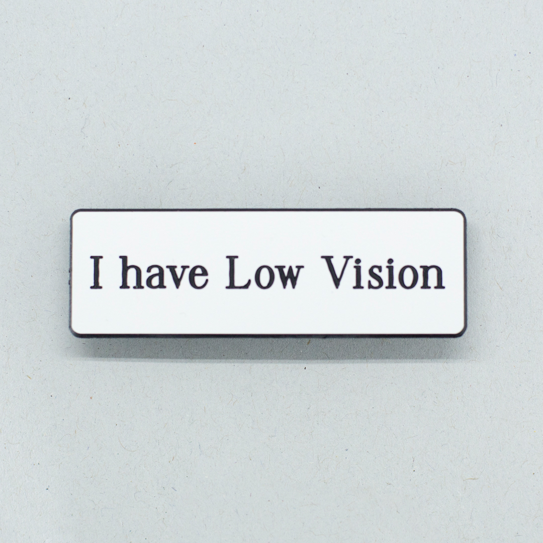 Small white badge with black text that says I have Low Vision