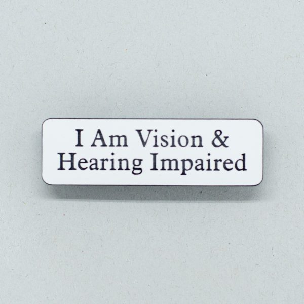Small white badge with black text that says I Am Vision & Hearing Impaired