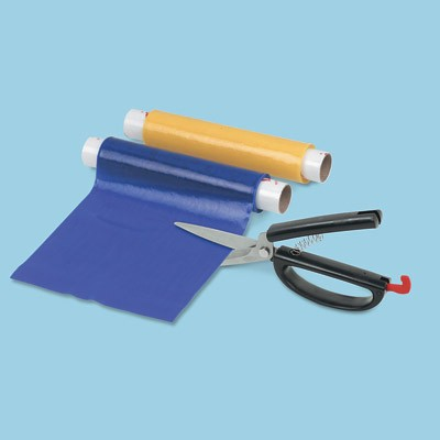 Blue dycem non slip reel unrolled and being cut to size with scissors.