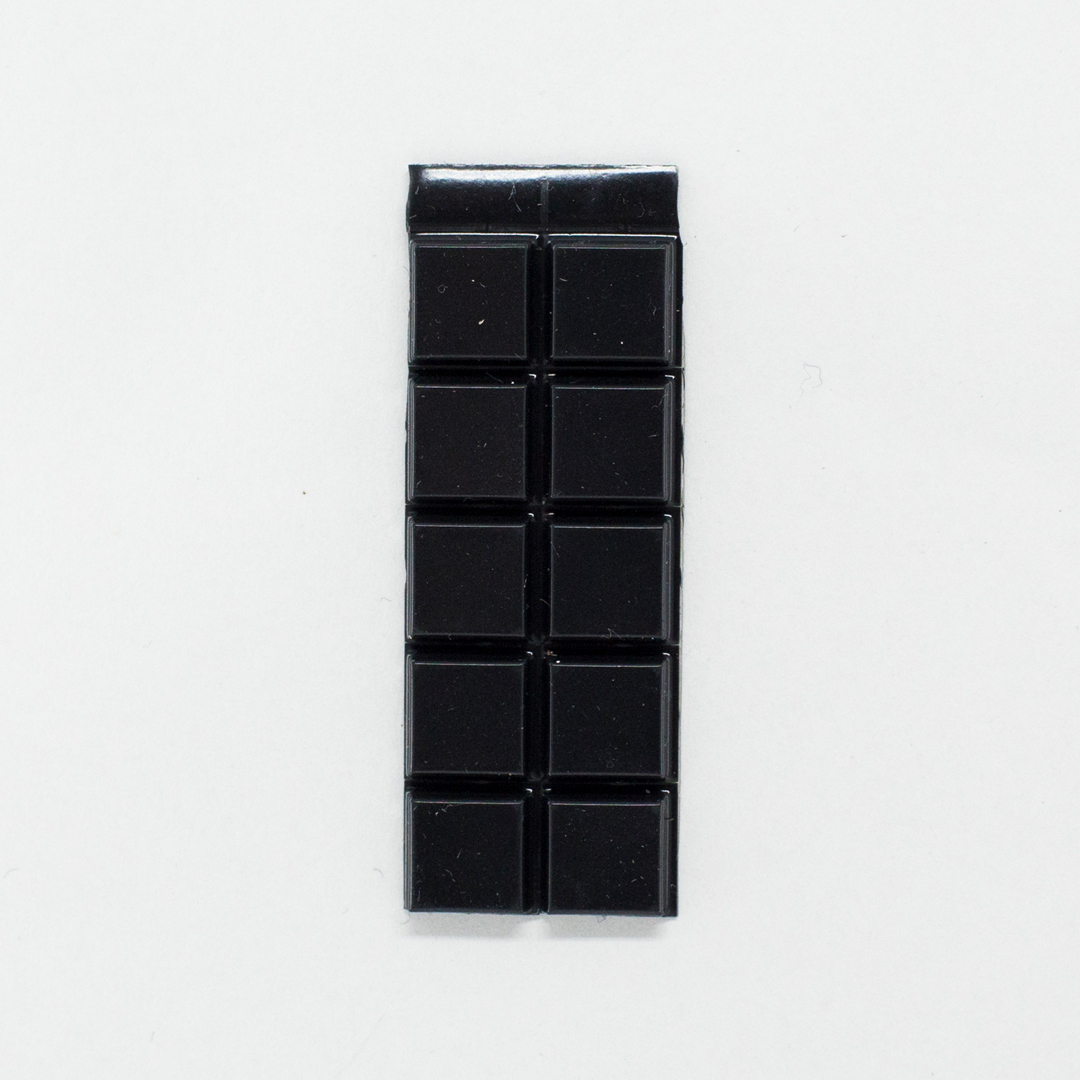 A set of black square bump-on tactile labels