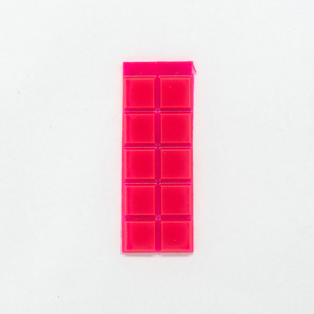 A set of pink square bump-on tactile labels