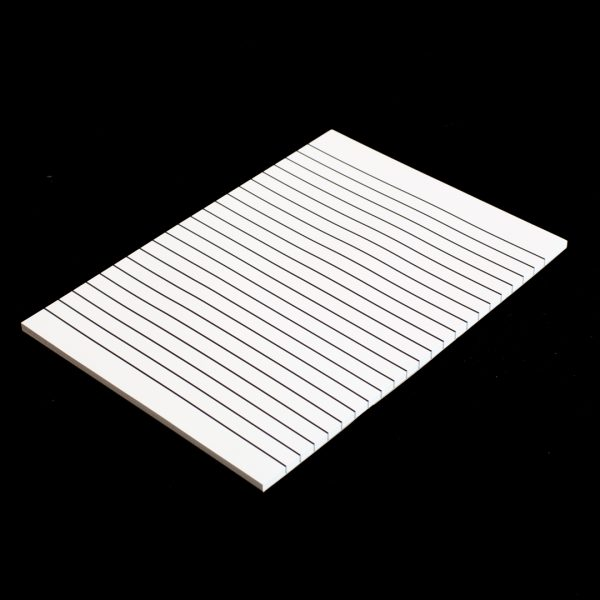 A white writing pad with 12mm black lines