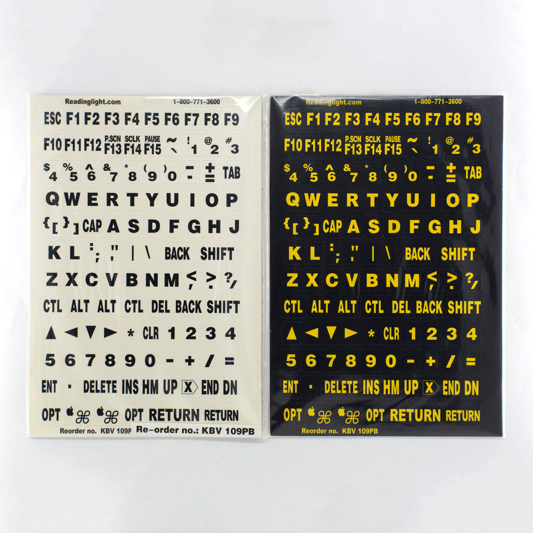 2 packs of keyboard stick on labels, one with black text on white and one with yellow text on black