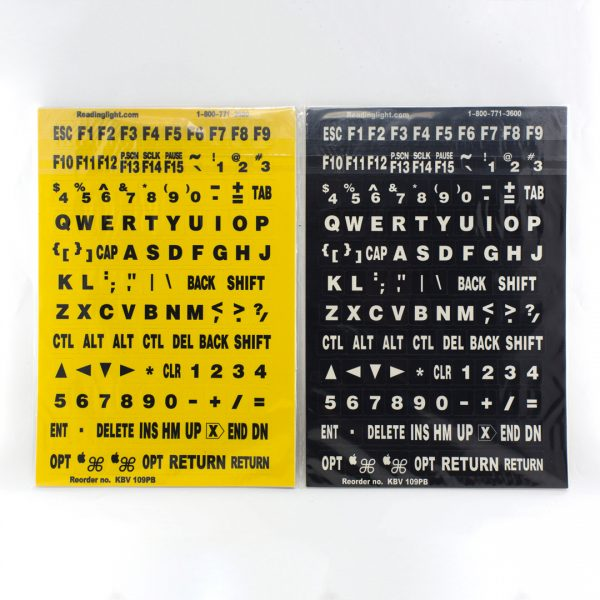 Two packs of stick on keyboard labels, one with black text on yellow and one with white text on black