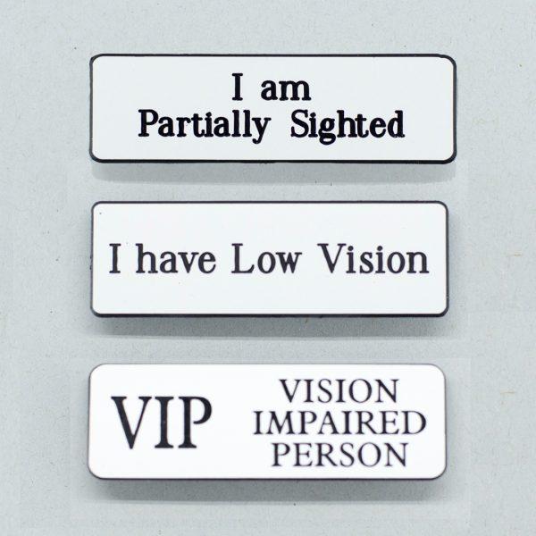 Three large lapel badges