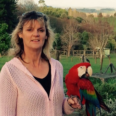 Denise with her bird Rikki the MacawPhoto of Denise with her bird Rikki the Macaw