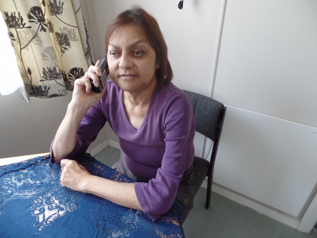 Person using TIS on telephone