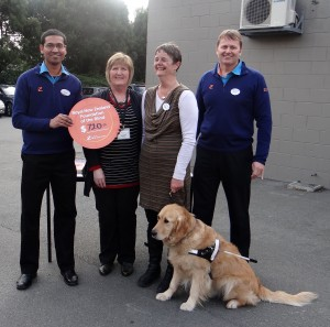 Photo left to right: Z Curletts Manager, Joy McClintock (Supporter Marketing and Fundraising), Petronella Spicer and guide dog Fletcher, and John (Z franchisee) at Z Curletts Road, Christchurch