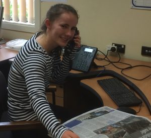 Student volunteer Rebecca Welsh busy on the phone