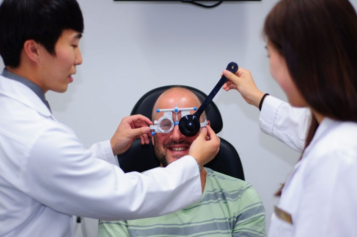 Photo of students doing a vision check.