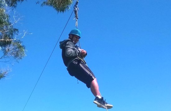 Joe Taka on the flying fox at the Rotary Camp