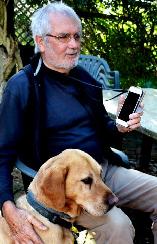 Lance and guide dog Yogi using BookLink