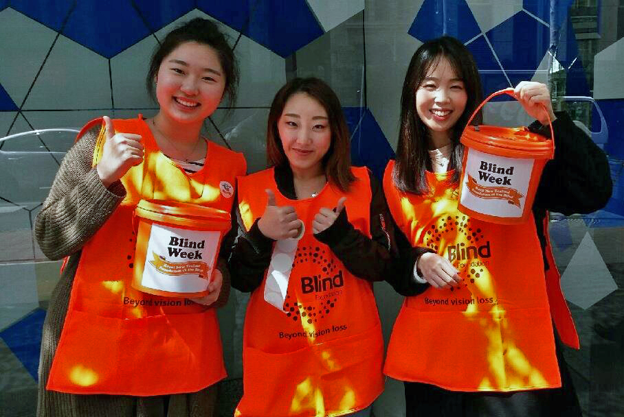 Three girls collecting for Blind Week