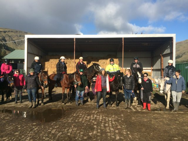 Group photo at horse riding school