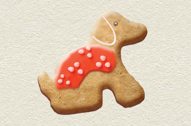 Cookie shaped like a red puppy guide dog