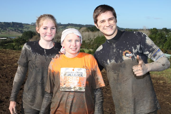 Photo of Hannah Josephson at the 2016 Tough Guy and Gal Challenge with her two guides