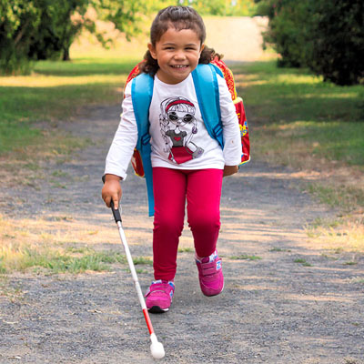 Marama walking with her cane
