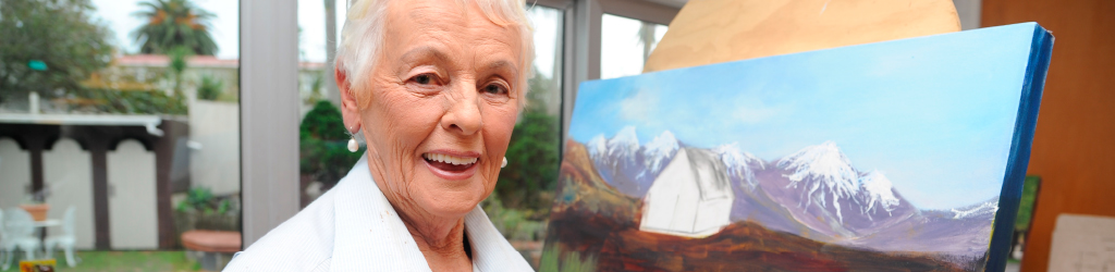 June with one of her paintings