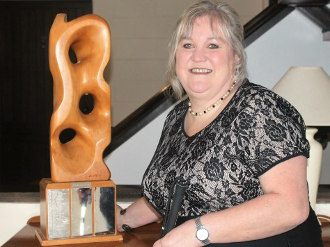 Julie Woods with the Chairman Award trophy