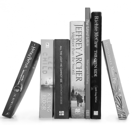 Vertical stack of six books