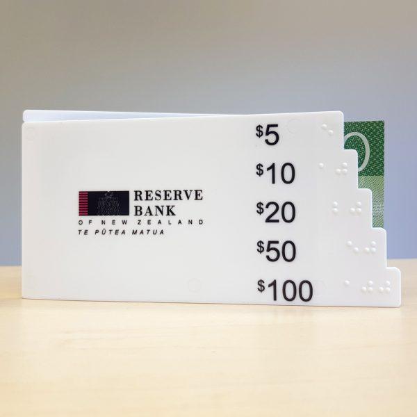 Note gauge with a twenty dollar note inside