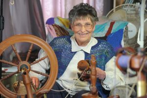 Maureen sitting with her knitting wheel