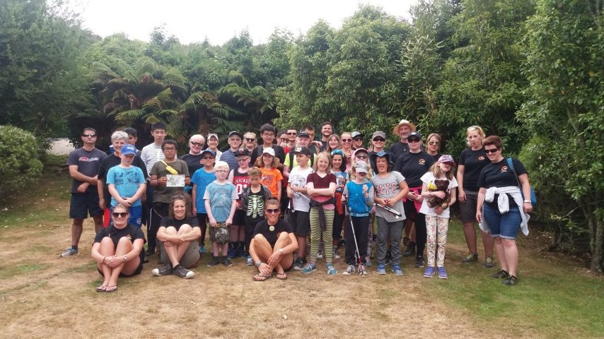 Image shows the participants at the annual Taupo summer camp outdoors amongst trees