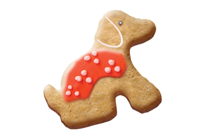 Puppy shaped biscuit with a red icing coat