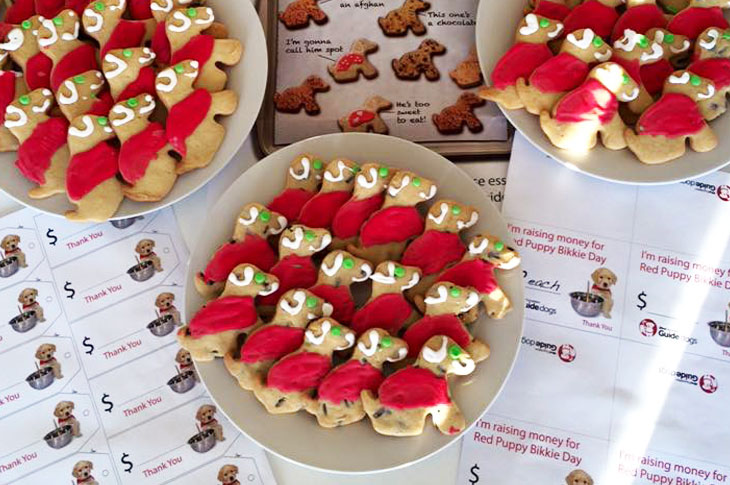Plate of red iced puppy shaped biscuits