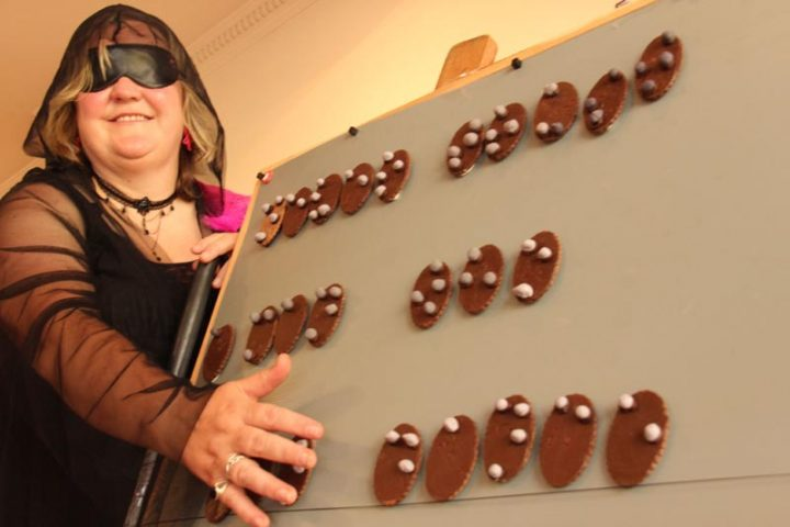 Image shows Julie Woods with some braille biscuits.