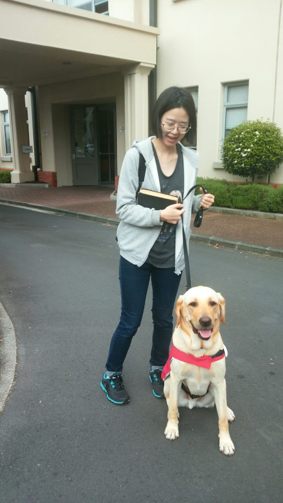 Image shows Yul Ri Jung with a guide dog.