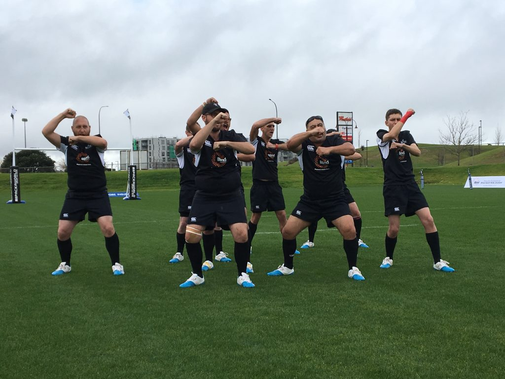 Image shows the New Zealand Blind Rugby team performing the 'Kapo e Au' haka.