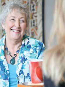 Woman smiling at a counsellor