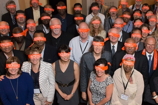 a group of people wearing blindfolds