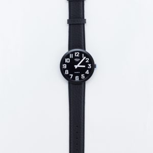 Jumbo size swiss made low vision watch has a black face with white numbers and a leather strap