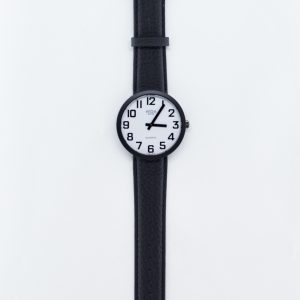 Jumbo sized low vision watch, swiss made with white back and black numbers and a black leather strap
