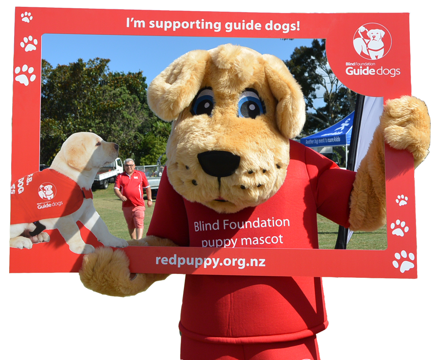 Guide dog mascot Marvel posing in a red photo frame