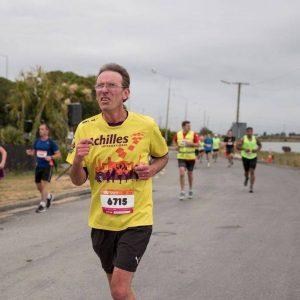 Image shows Mike Asmussen running in a marathon.