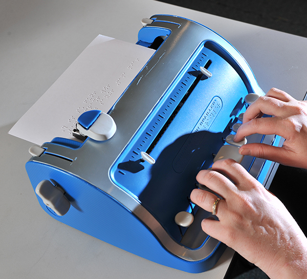 A blue braille type writer
