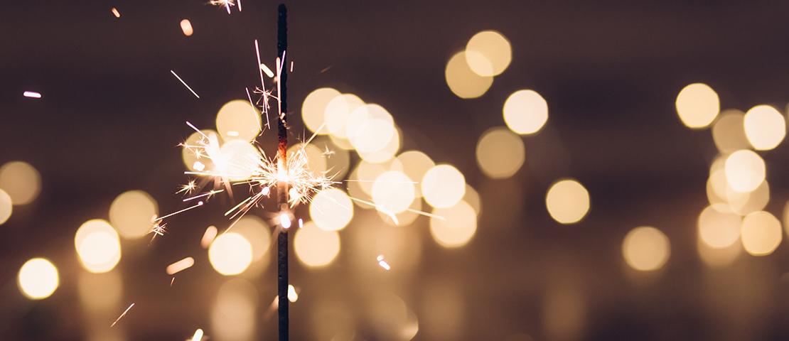 Sparkler against a dark background.