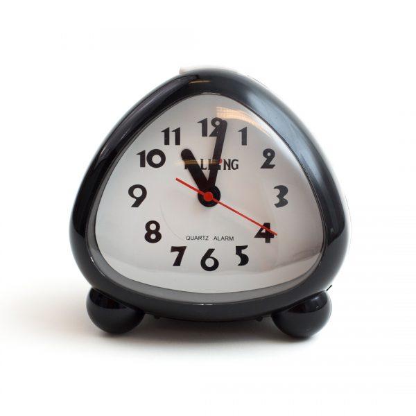 Triangle shaped analogue audible alarm clock