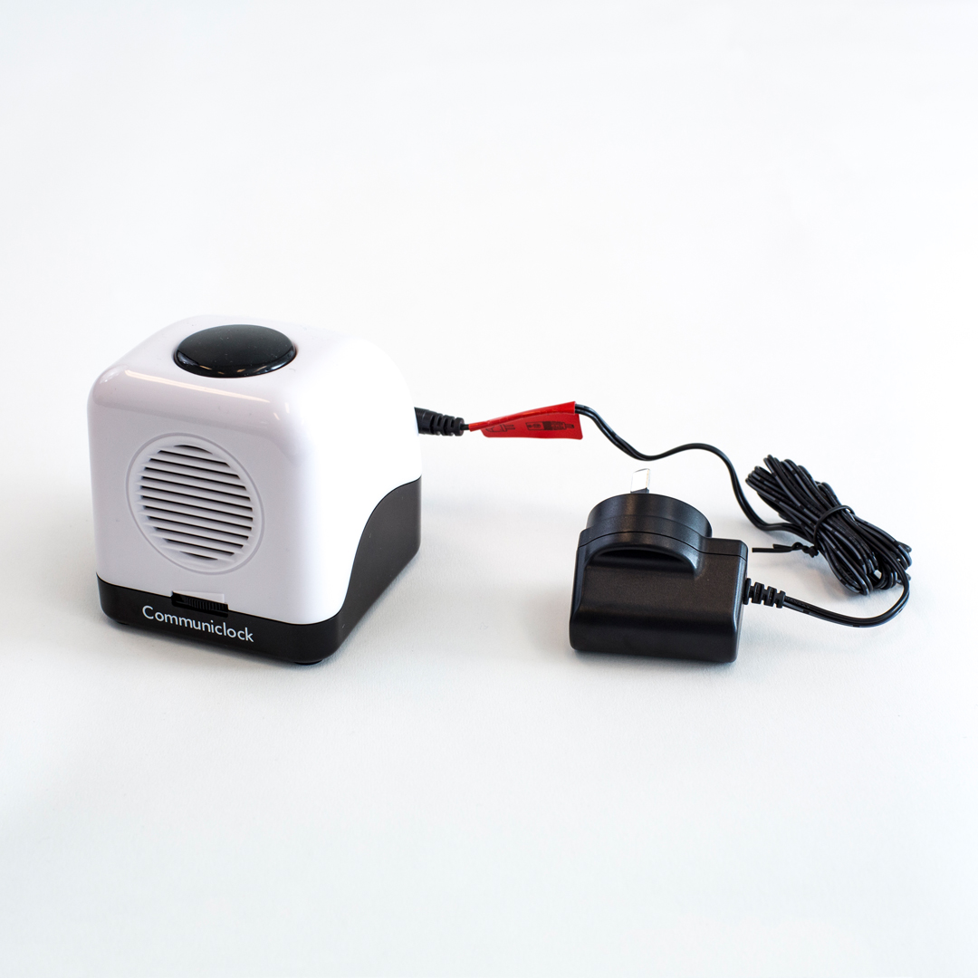Communiclock with its power plug adapter