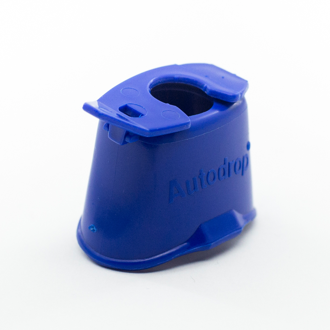 A blue autodrop eyedrop dispenser