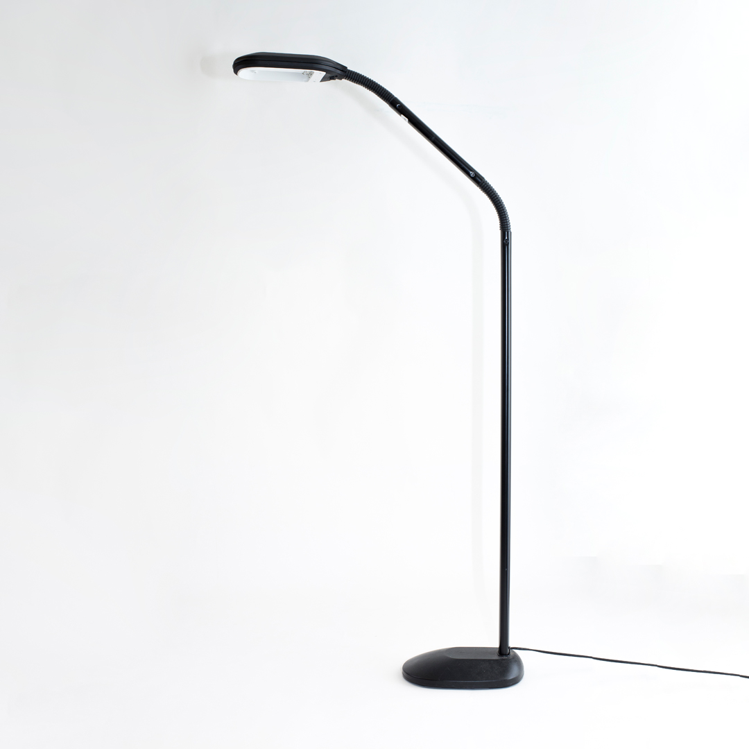 Black floor standing lamp with fluorescent bulb